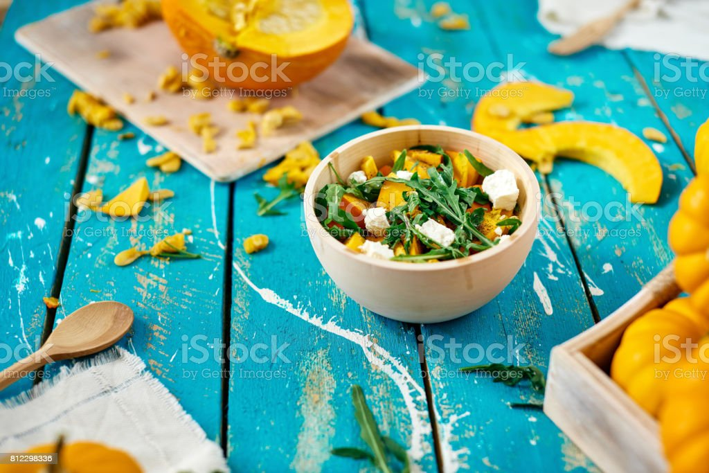 Healthy pumpkin salad with white cheese and arugula stock photo