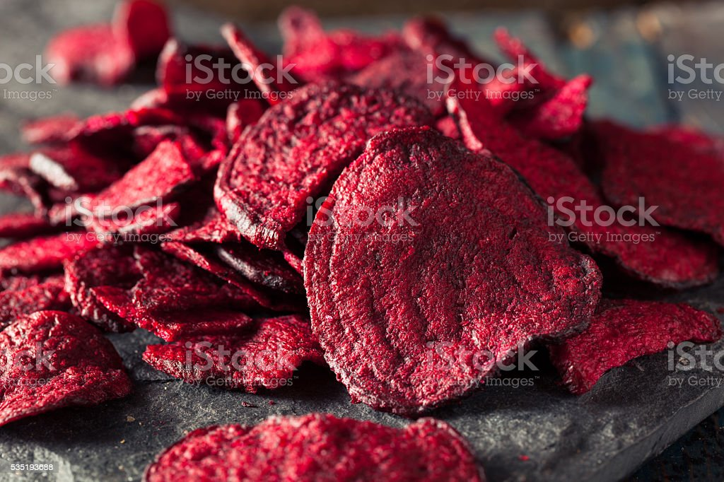 Healthy Purple Baked Beet Chips stock photo