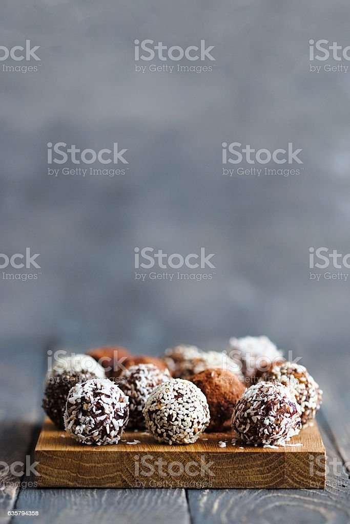 Healthy raw energy balls on a grey background stock photo