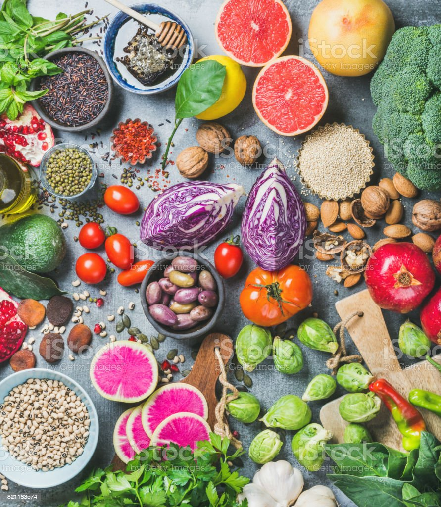 Healthy raw food variety over grey concrete background stock photo