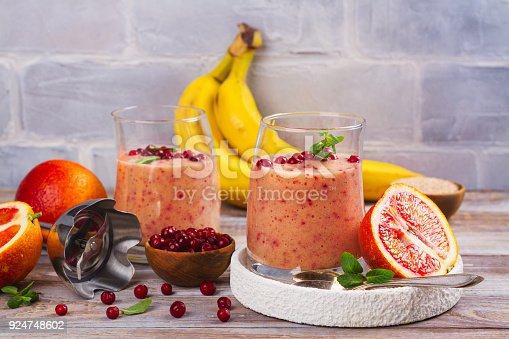 istock Healthy refreshing pink smoothie with apple, red oranges, cowberry and bran 924748602