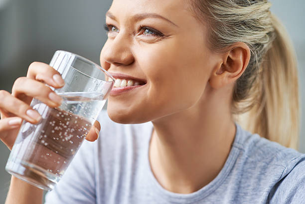healthy refreshment - drinking water stock photos and pictures