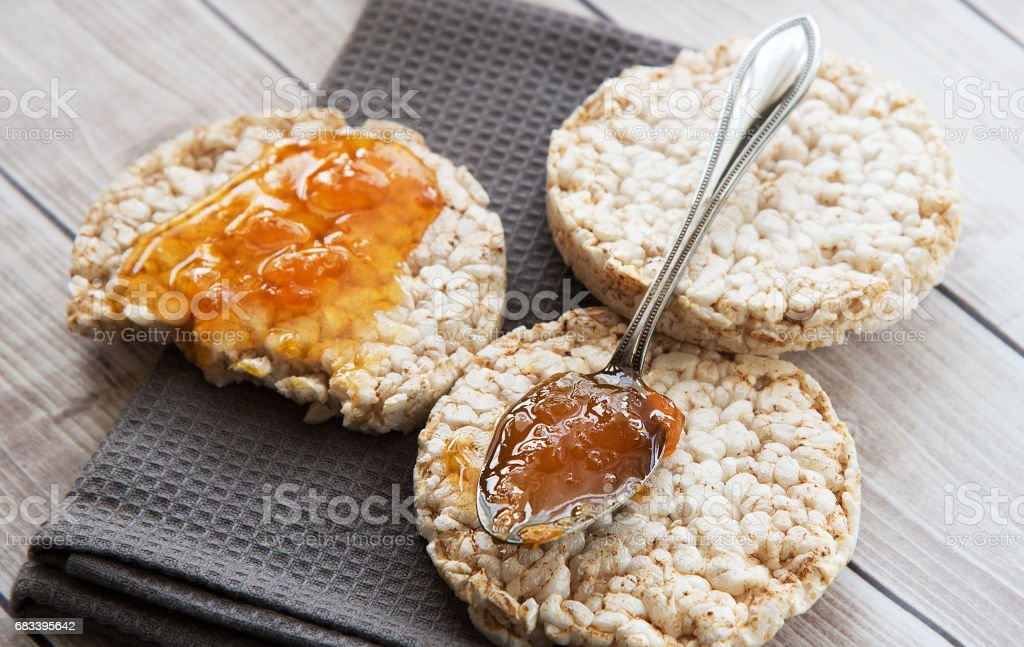 Healthy rice cake with bio jam close up stock photo