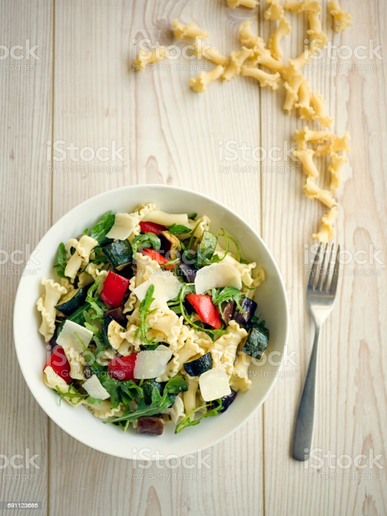 Healthy roasted vegetable pasta salad stock photo