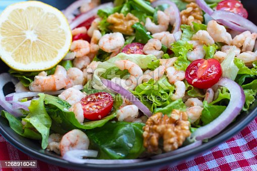 Healthy salad plate. Fresh seafood recipe. Grilled shrimp and fresh vegetable salad. Fried shrimps. Healthy foods.
