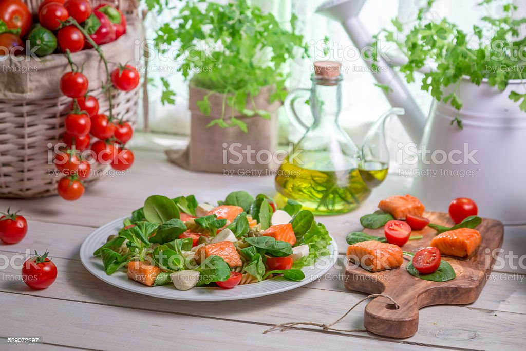 Healthy salad with fresh vegetables and salmon stock photo