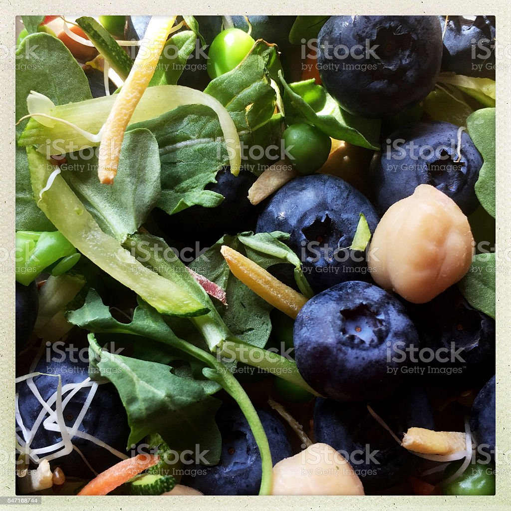 Healthy Salad with Greens and Blueberries stock photo