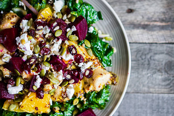 Healthy salad with grilled chicken,kale.beets and goat cheese stock photo