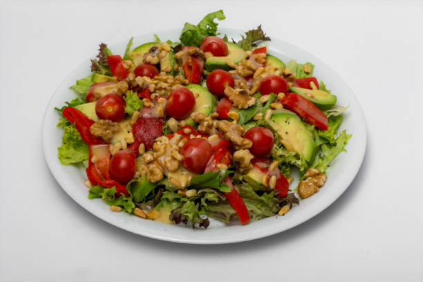 Healthy salad with honey mustard dressing stock photo