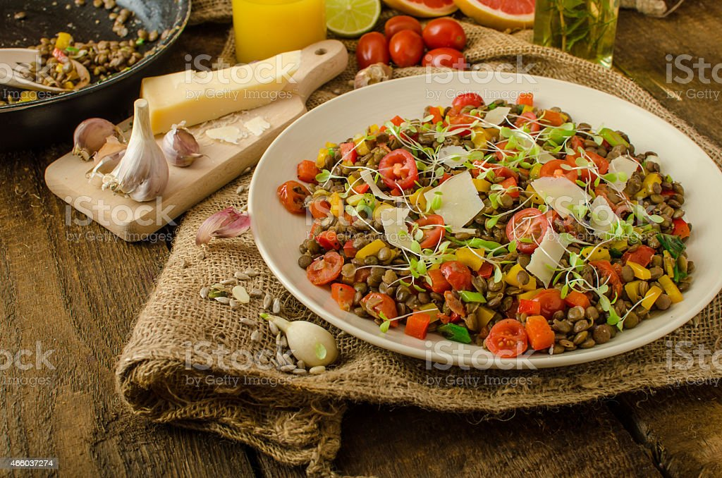 Healthy salad with lentils on wooden table stock photo