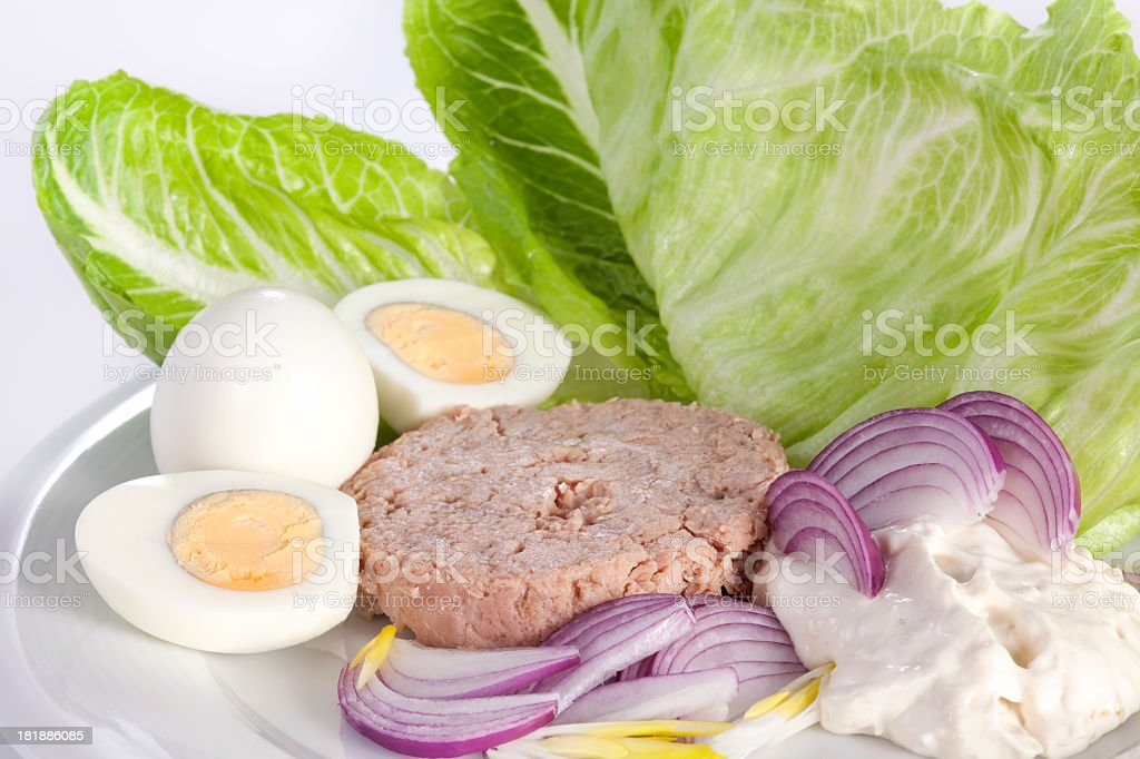 Healthy salad with tuna, egg and onion. royalty-free stock photo
