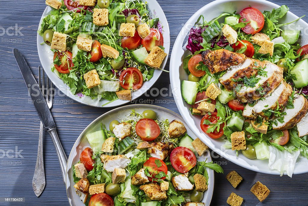 Healthy salads made of hot chicken and fresh royalty-free stock photo