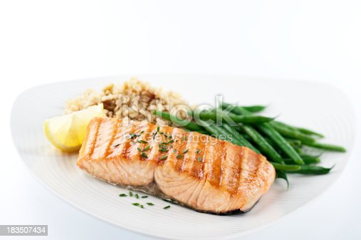 SEVERAL MORE IN THIS SERIES. Salmon steak with green beans and brown rice pilaf for a healthy dinner.  Shallow DOF.
