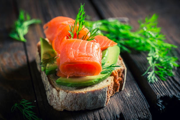 Healthy sandwich with avocado, dill and salmon stock photo