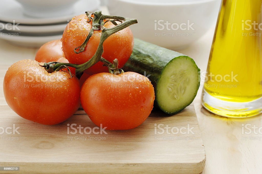 healthy scene, vine tomatoes, cucumber, oil royalty-free stock photo