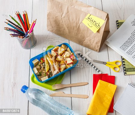 istock Healthy school lunch box on white wood background, top view 845910874