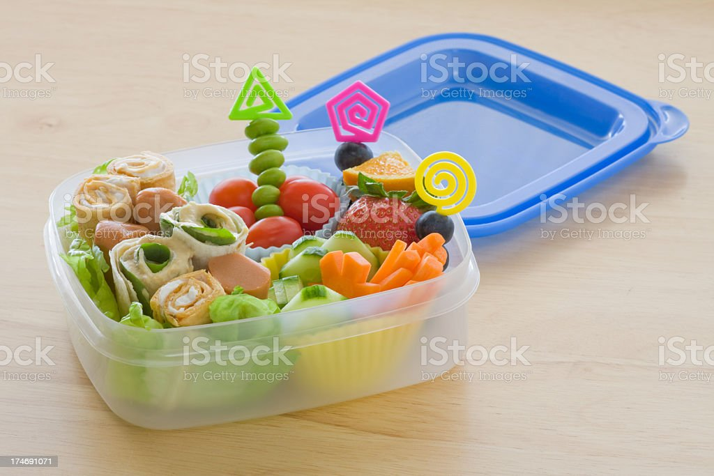 Healthy school lunch box with tomatoes, carrots and fruit royalty-free stock photo