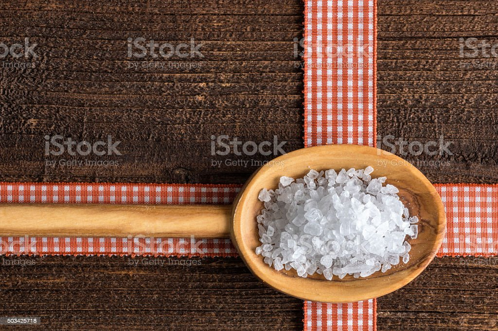 Healthy sea salt  on a wooden spoon stock photo