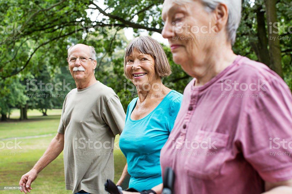 Healthy senior people walking in park - Photo