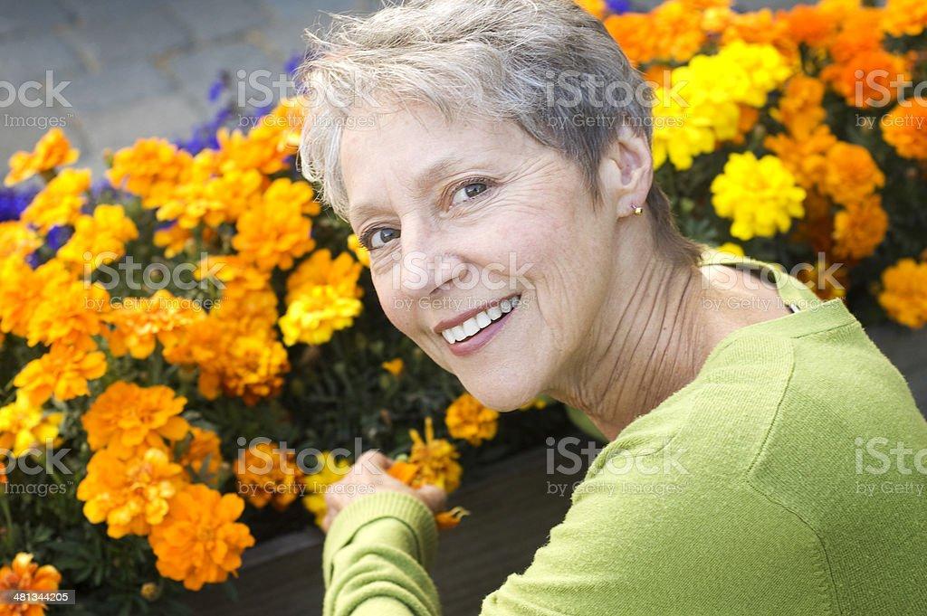 Healthy Senior Woman Gardening royalty-free stock photo
