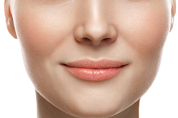 Healthy Smile. Woman Smile Closeup. Beautiful Lips Healthy skin concept Healthy Smile. Woman Smile Closeup. Beautiful Lips Healthy skin concept. Studio shot. human nose stock pictures, royalty-free photos & images