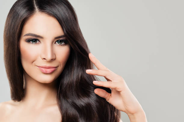 Healthy Smiling Brunette Model with Healthy Hair and Natural Makeup. Beautiful Young Woman Portrait stock photo
