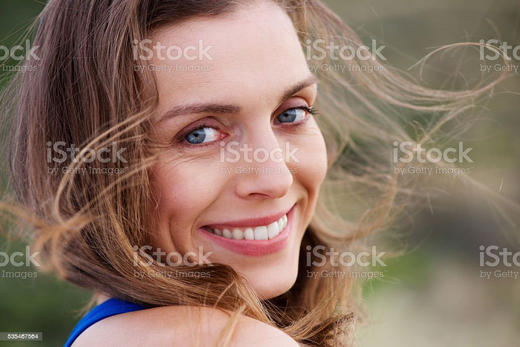 Healthy smiling woman outside stock photo