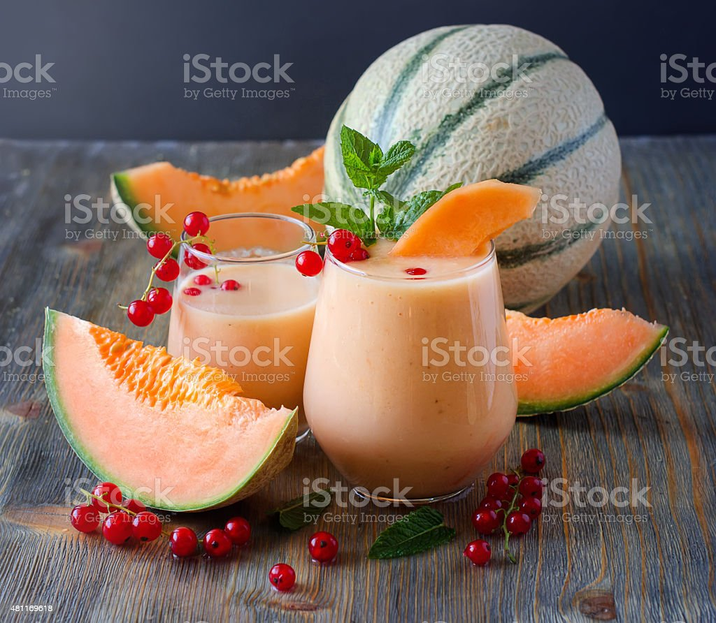 Healthy smoothie drink with red currant berries and melon stock photo