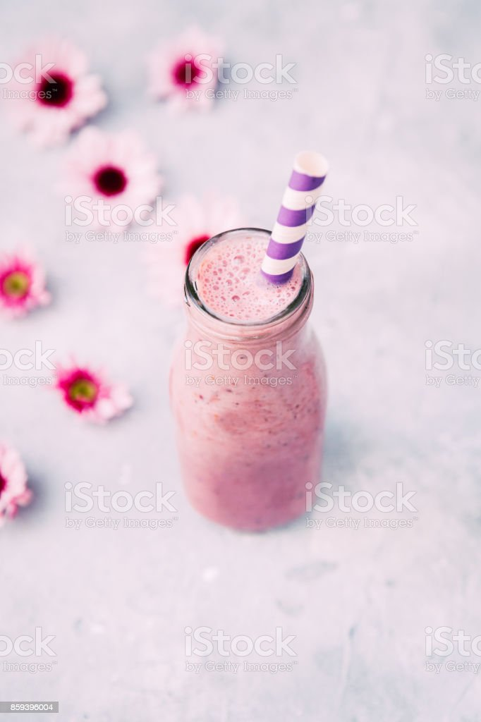 Healthy smoothie in a glass bottle stock photo