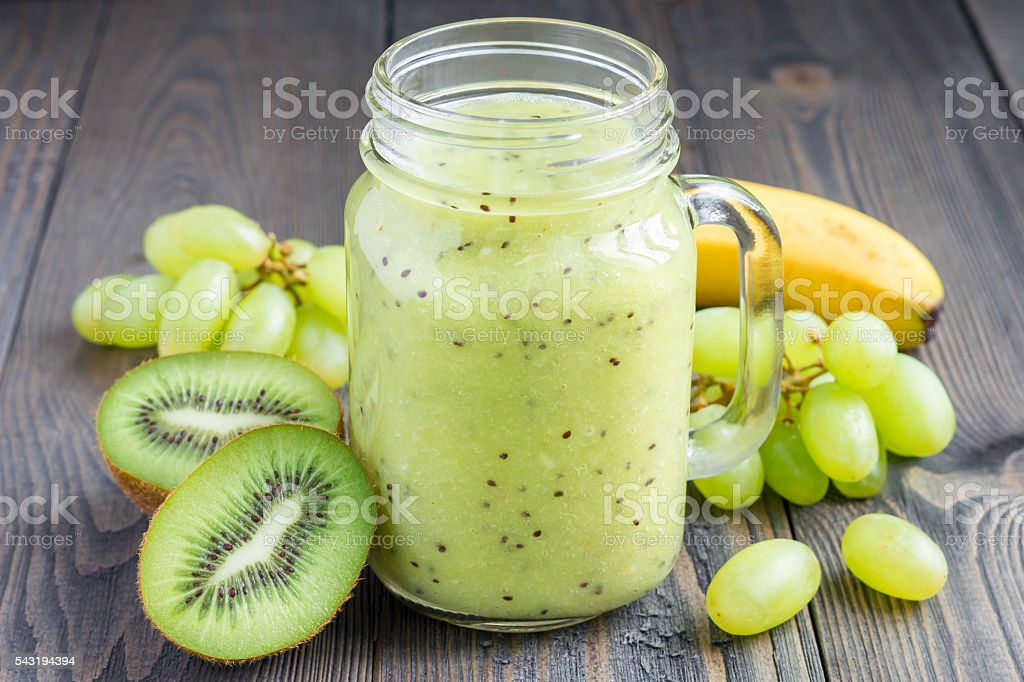 Healthy smoothie with kiwi, green grape, and banana in jar - Photo