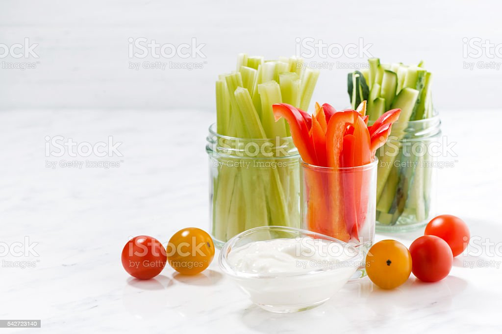 healthy snacks, mixed vegetables and yogurt on a white table – Foto
