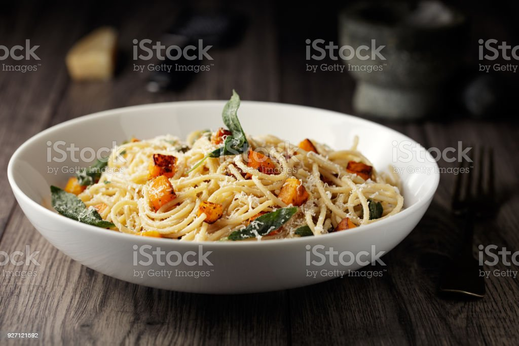 Healthy spaghetti with roasted butternut squash and sage butter stock photo