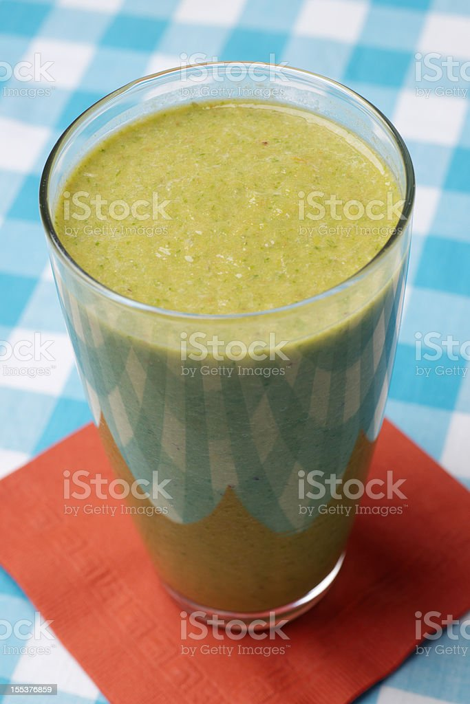 Healthy Spinach Smoothie in Glass Jar or Mug royalty-free stock photo