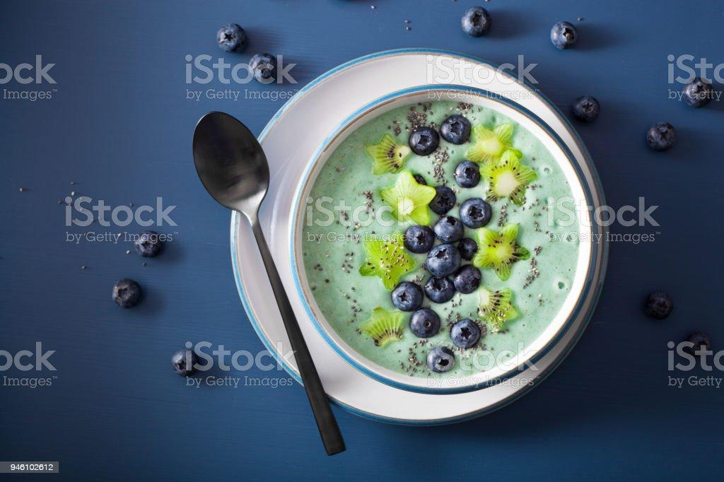 healthy spirulina smoothie bowl with blueberry, kiwi stars, chia seed stock photo