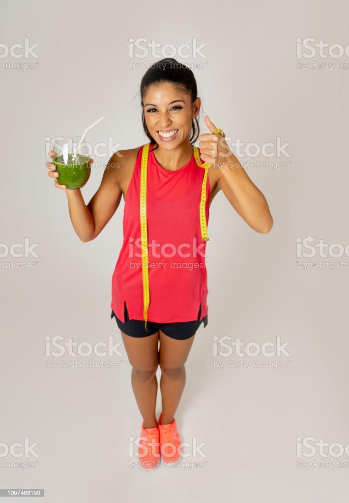 Healthy Sport Woman Drinking Fresh Green Detox Cleanse