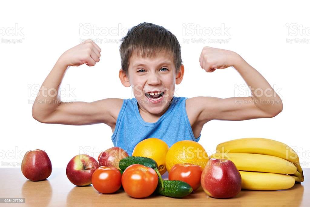 Healthy sporty boy with fruits and vegetables isolated stock photo