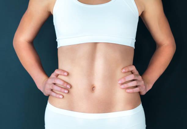 saudável começa com o estômago - abdome - fotografias e filmes do acervo