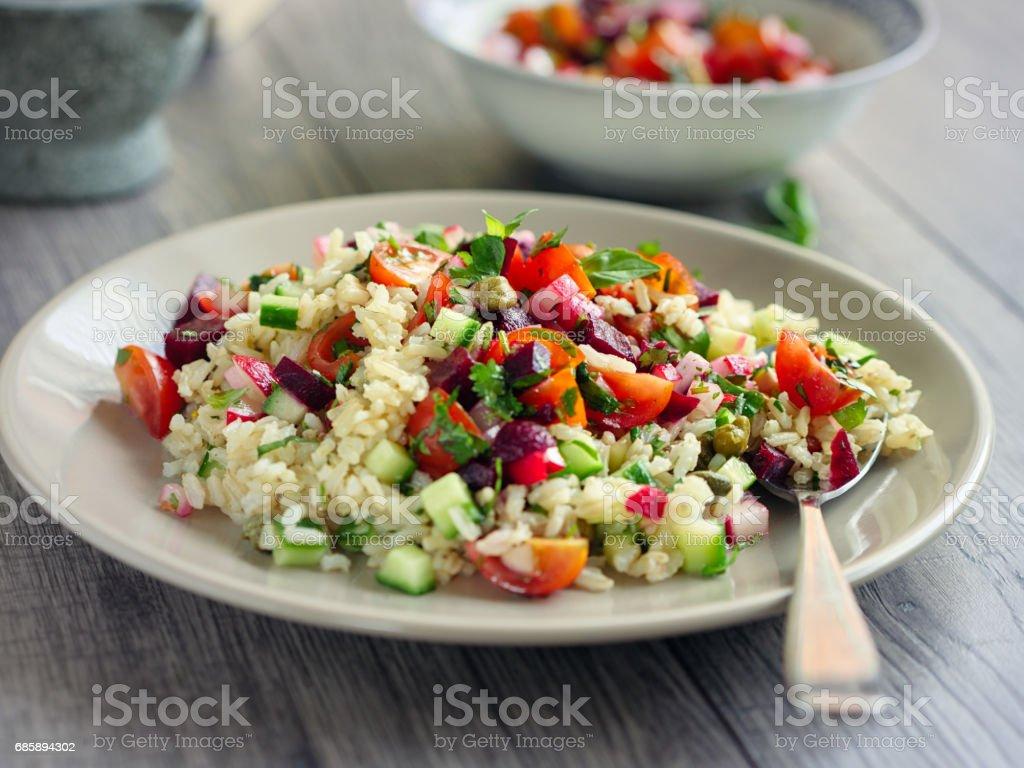 Healthy summer brown rice salad stock photo