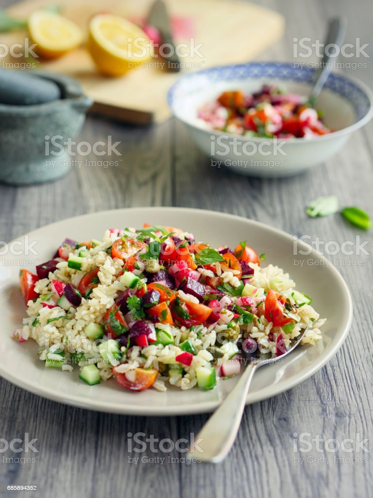 Healthy summer brown rice salad stock photo