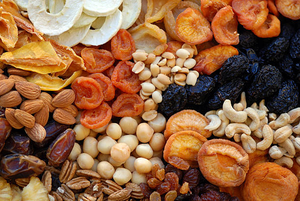 healthy sundried organic fruit & nuts - dried fruit stock photos and pictures