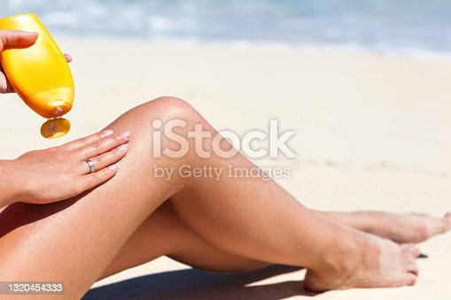 istock Healthy suntanning with SPF bodycare 1320454333