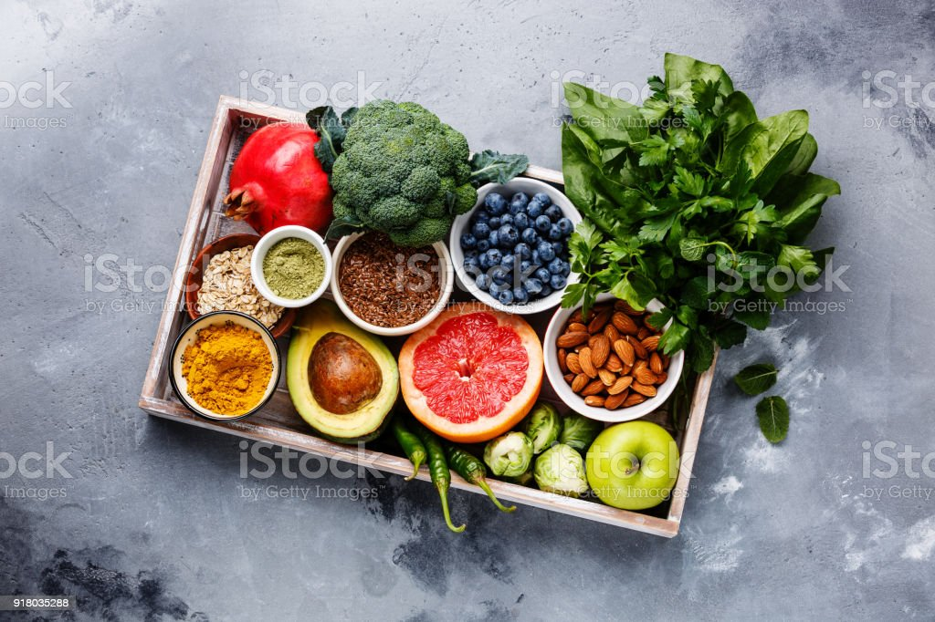Healthy superfood clean eating selection in wooden box stock photo