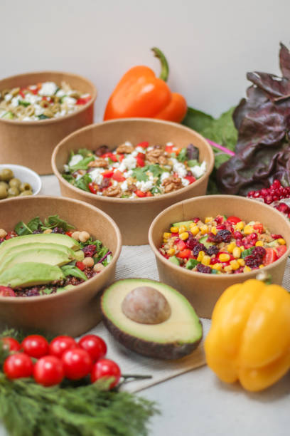 Healthy takeaway salad bowls in recyclable containers stock photo