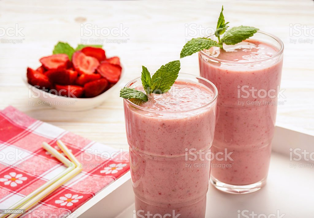 Healthy tasty milk cocktails with strawberries and banana. stock photo