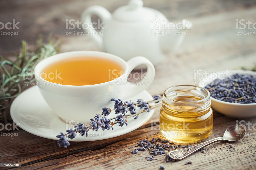 Healthy tea cup, honey, dry lavender flowers and teapot stock photo