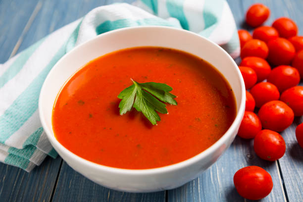 Healthy Tomato Soup on wood background stock photo