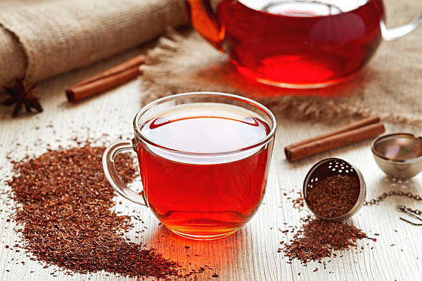 Healthy traditional herbal rooibos beverage tea with spices on vintage stock photo