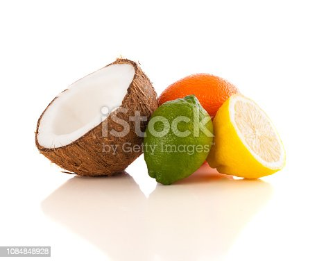 istock Healthy tropical fresh fruits on white background 1084848928