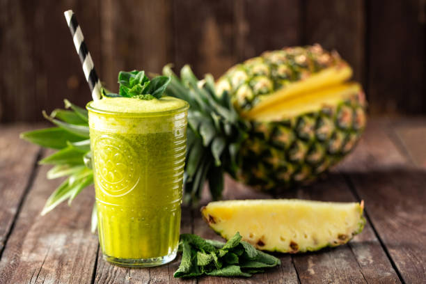 Healthy tropical smoothie with followed by astonishing pineapple decoration stock photo