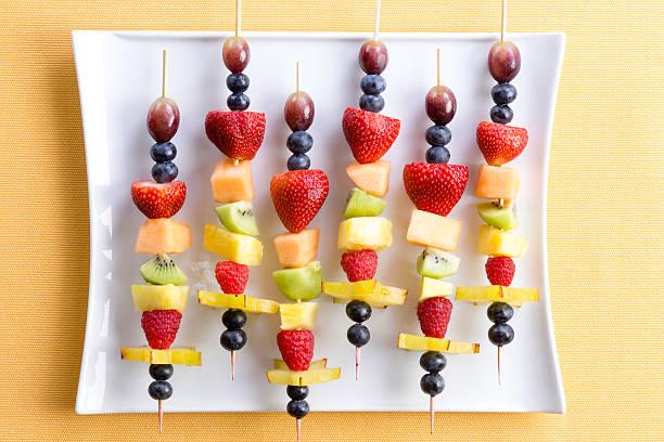 Healthy tropical summer fruit kebabs stock photo